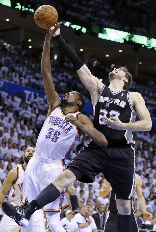 Oklahoma City Thunder's Kevin Durant and San Antonio Spurs' Tiago Splitter grab for a rebound during first half action in Game 6 of the Western Conference finals Saturday May 31, 2014 at Chesapeake Energy Arena in Oklahoma City, OK. Photo: Edward A. Ornelas, San Antonio Express-News