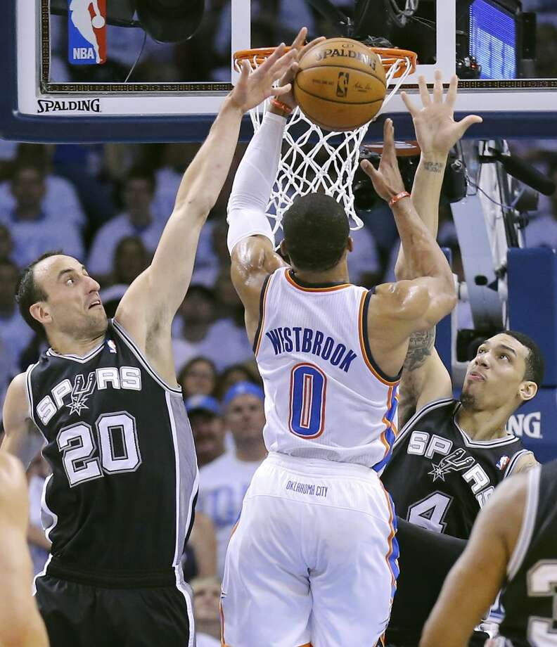 San Antonio Spurs' Manu Ginobili and Danny Green defend Oklahoma City Thunder's Russell Westbrook during first half action in Game 6 of the Western Conference finals Saturday May 31, 2014 at Chesapeake Energy Arena in Oklahoma City, OK. Photo: Edward A. Ornelas, San Antonio Express-News