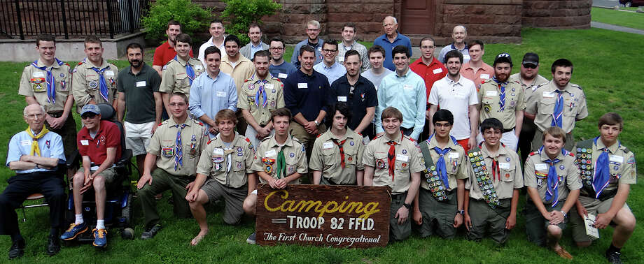 Eagle Scouts pose for a group portrait at Troop 82's celebration of its 100-plus Eagles at First Church Congregational on Saturday afternoon. Photo: Mike Lauterborn / Fairfield Citizen