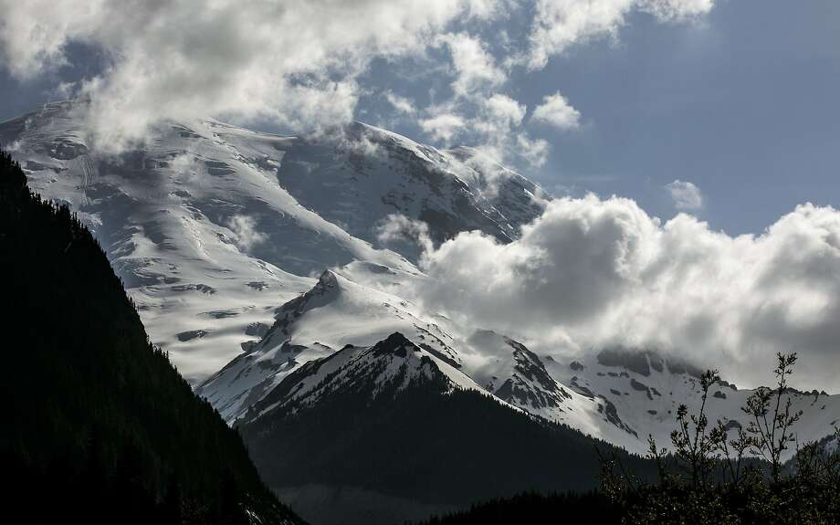 Park officials say the area at Mount Rainier where six climbers apparently fell is too dangerous to search now. The area will be checked periodically by air. Photo: Bettina Hansen, Associated Press