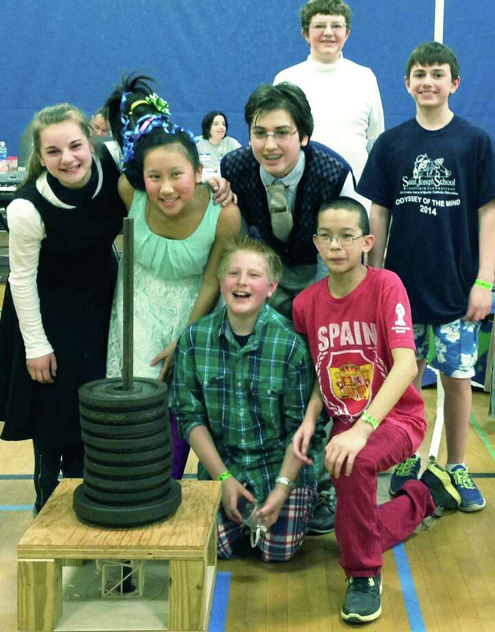 The St. Joseph School of Brookfield's Odyssey of the Mind team features, from left to right, front row, Nathan Mulder of New Milford and Matt Villanueva of Brookfield; middle row, Julia Iannucci of Bridgewater, Jessica Garcia of New Milford, David Mercier of New Milford and Sean DeSantis of New Milford; and, back, Stephen Gillen of Danbury. May 2014  Courtesy of Nicole DeSantis Photo: Contributed Photo / The News-Times Contributed