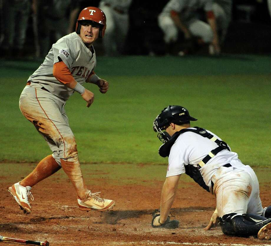 Texas' Mark Payton, left, scores the game-tying run past Rice's John Clay Reevs during the eighth inning of a Houston NCAA baseball regional game, Saturday, May 31, 2014, at Reckling Park in Houston. Photo: Eric Christian Smith, For The Chronicle