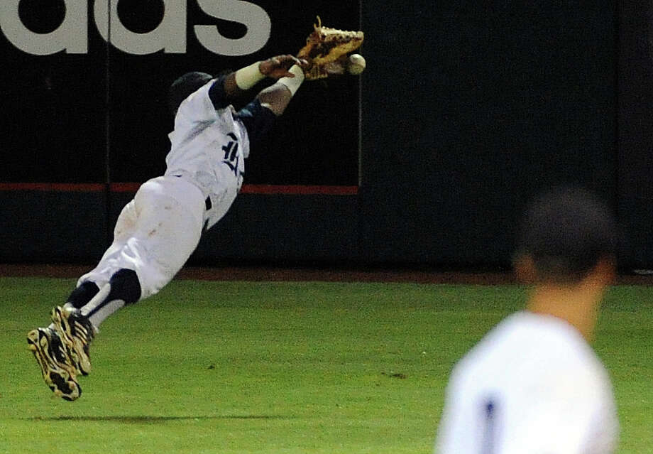 Rice center fielder Leon Byrd can't catch Texas' Zane Gurwitz's line drive for a double during the eleventh inning of a Houston NCAA baseball regional game, Saturday, May 31, 2014, at Reckling Park in Houston. Photo: Eric Christian Smith, For The Chronicle