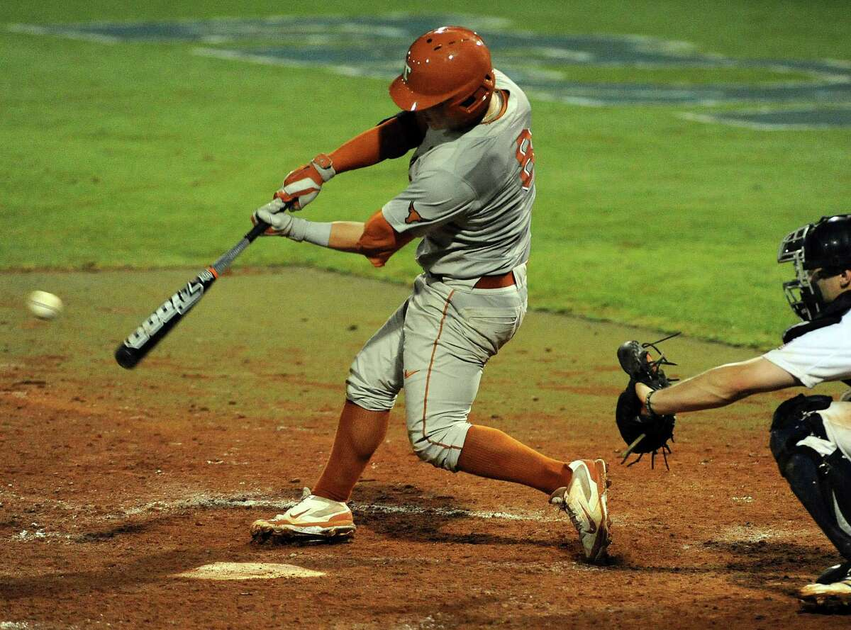 Texas' Brooks Marlow connects for an RBI, go-ahead single during the eleventh inning of a Houston NCAA baseball regional game, Saturday against Rice, May 31, 2014, at Reckling Park in Houston.