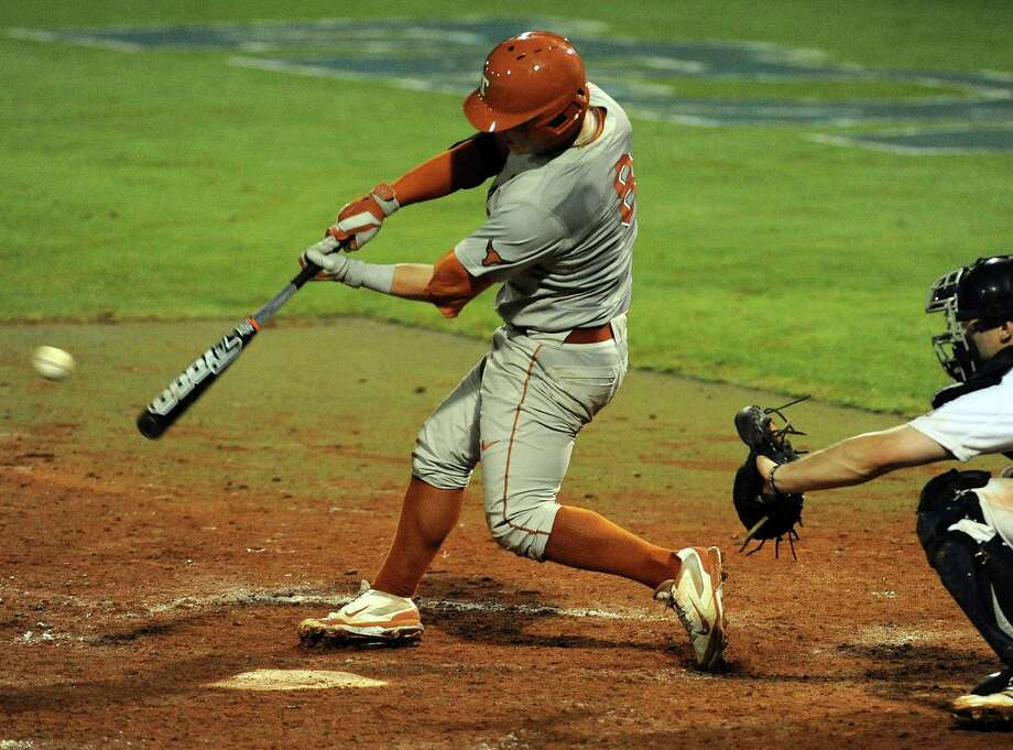 Texas' Brooks Marlow connects for an RBI, go-ahead single during the eleventh inning of a Houston NCAA baseball regional game, Saturday against Rice, May 31, 2014, at Reckling Park in Houston. Photo: Eric Christian Smith, For The Chronicle