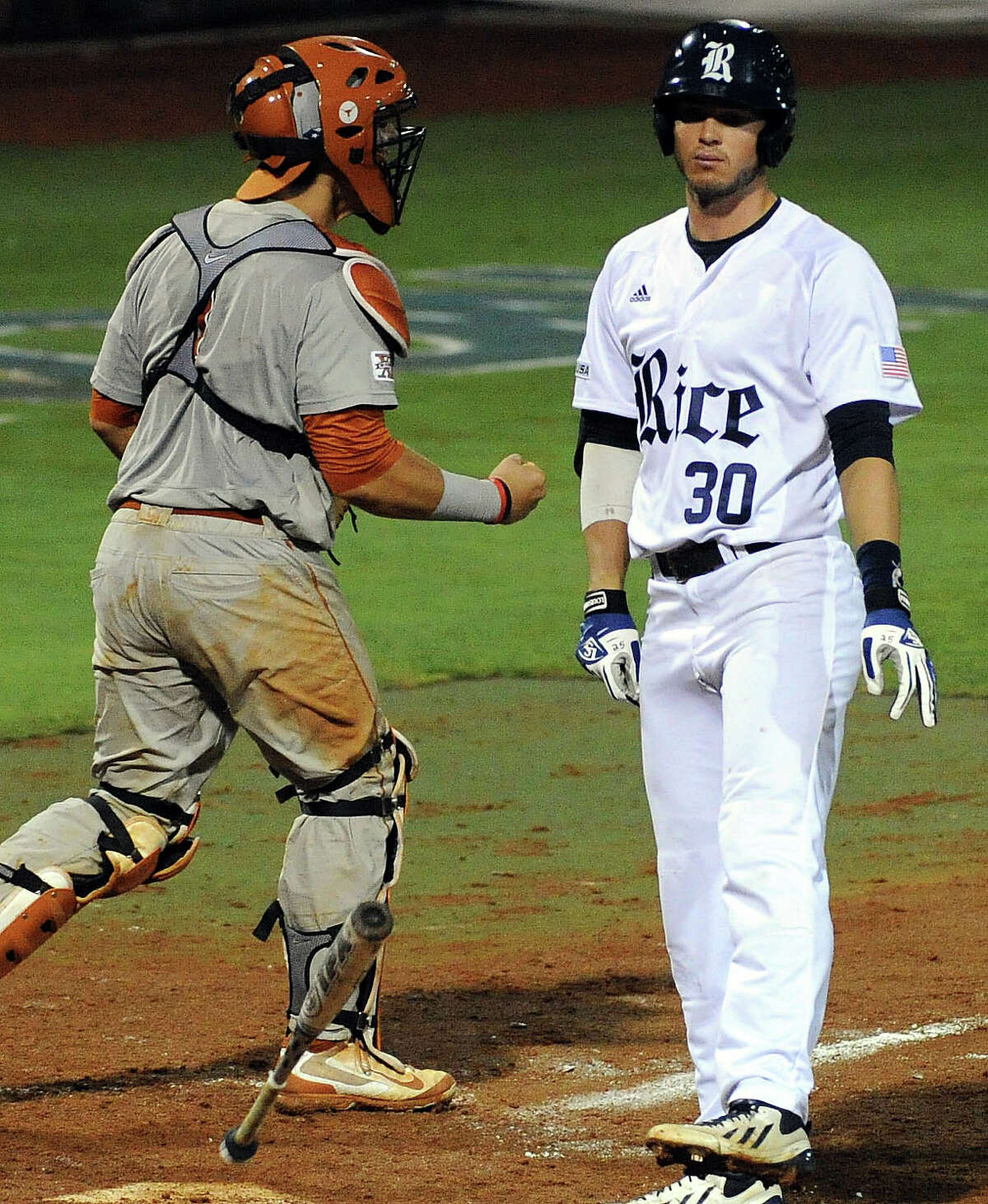 Rice's Chase McDowell (30) throws his bat after striking out to end the game during the eleventh inning of a Houston NCAA baseball regional game, won by Texas, 3-2, Saturday, May 31, 2014, at Reckling Park in Houston.