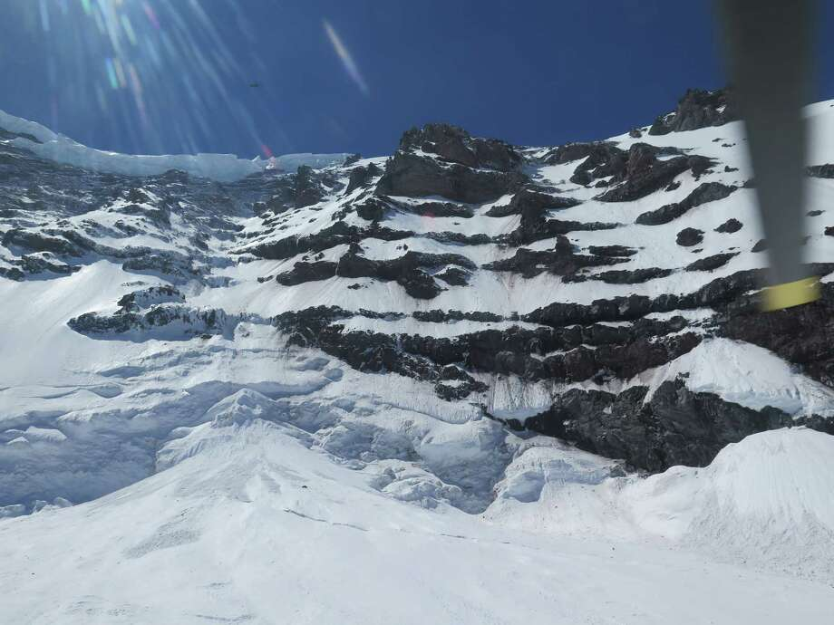 This photo provided by the National Parks Service, shows the Liberty Ridge Area of Mount Rainier as viewed from the Carbon Glacier, Saturday, May 31, 2014, in Washington state. A climber went missing from the area Thursday while a team of three descended down the mountain above the 14,000-foot level. Photo: Uncredited, AP  / AP2014
