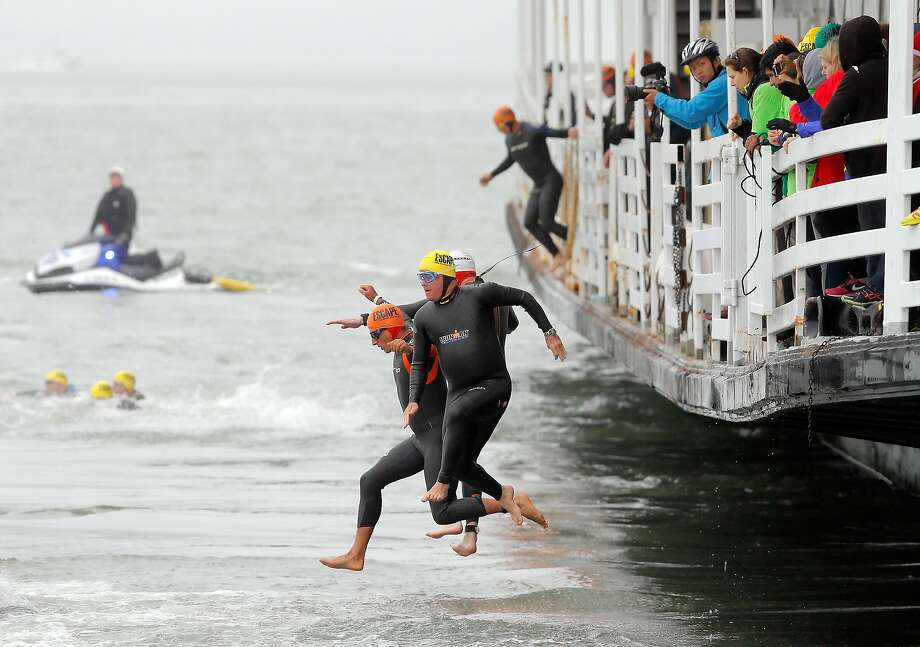 Swimmers leap into the water from the Hornblower San Francisco Belle at the start of the 34th annual Escape from Alcatraz Triathlon in San Francisco, Calif., on Sunday, June 1, 2014. Photo: Carlos Avila Gonzalez, The Chronicle