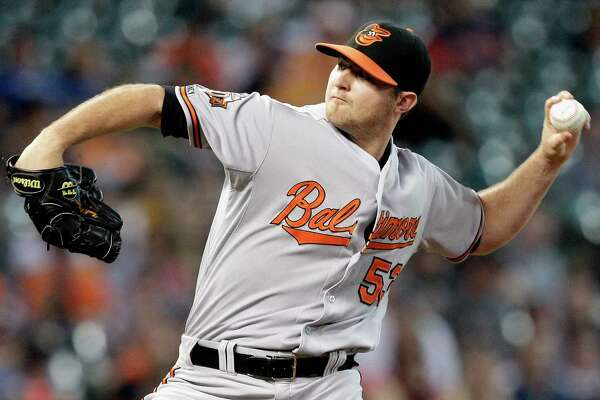 HOUSTON, TX - MAY 31:  Zach Britton #53 of the Baltimore Orioles throws in the ninth inning against the Houston Astros at Minute Maid Park on May 31, 2014 in Houston, Texas.