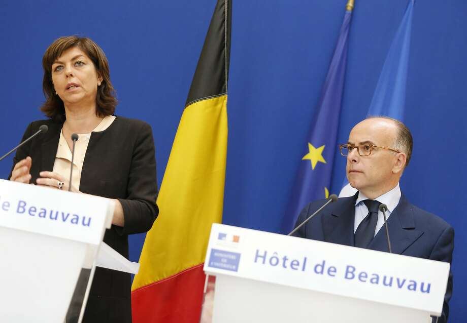 Belgium Interior Minister Joelle Milquet (left) and French counterpart Bernard Cazeneuve announce in Paris an arrest in the slayings at the Jewish Museum in Brussels May 24. Photo: Jacques Brinon, Associated Press