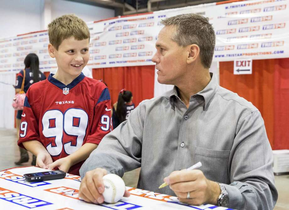 The Tristar 28th Annual Summer Collectors Show is being held this weekend at NRG (Reliant) Center, Hall E. Thousands attend to buy and sell memorabilia and get autographs and photographs with sports stars. ID: Sam Ullrich, age 8, of Conroe, gets to meet with baseball star Craig Biggio. Sunday  June 1, 2014 Photo: Craig Hartley, For The Chronicle / Copyright: Craig H. Hartley