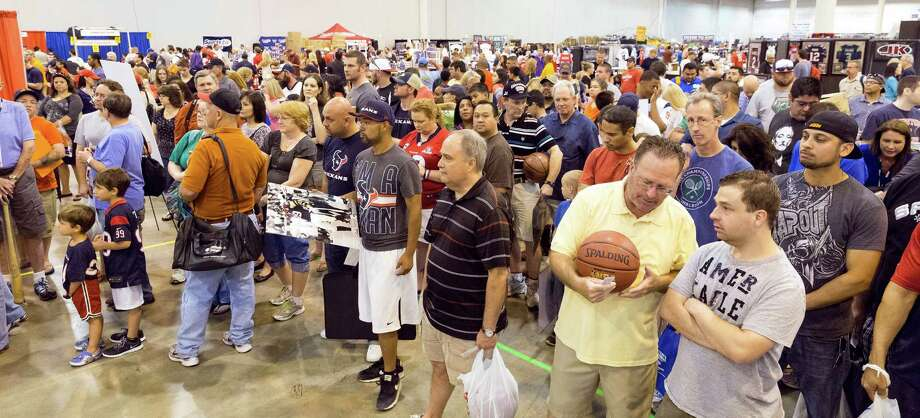 The Tristar 28th Annual Summer Collectors Show is being held this weekend at NRG (Reliant) Center, Hall E. Thousands attend to buy and sell memorabilia and get autographs and photographs with sports stars.