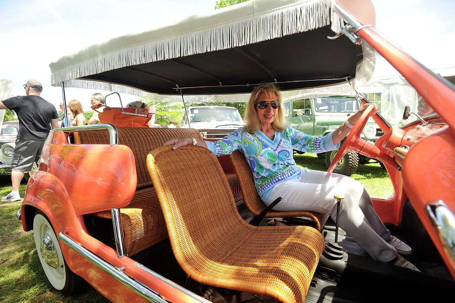Madeline D'Amerosio, of Southport, poses in her favorite vehicle of the show, a 1959 Fiat 600 Jolly, during the Greenwich Concours d'Elegance at Roger Sherman Baldwin Park in Greenwich, Conn., on Sunday, June 1, 2014. Photo: Jason Rearick / Stamford Advocate
