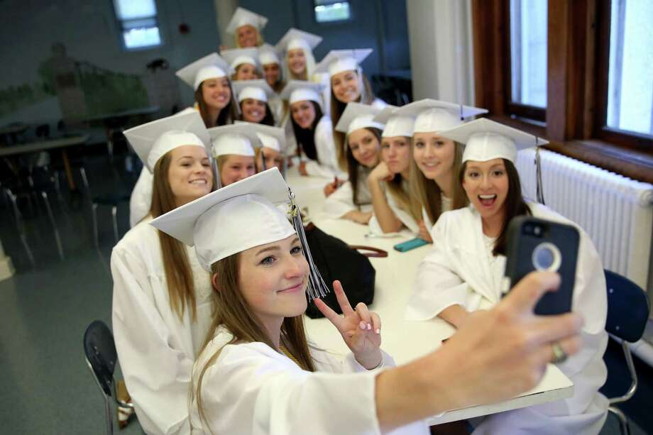 "Lauralton High School graduate Katherine Foley, left of Wilton takes a ""selfie"" group photo with friends during before commencement exercises on Sunday June 1, 2014 in Milford, Conn. Photo: Mike Ross / Mike Ross Connecticut Post freelance - @www.mikerossphoto.com"