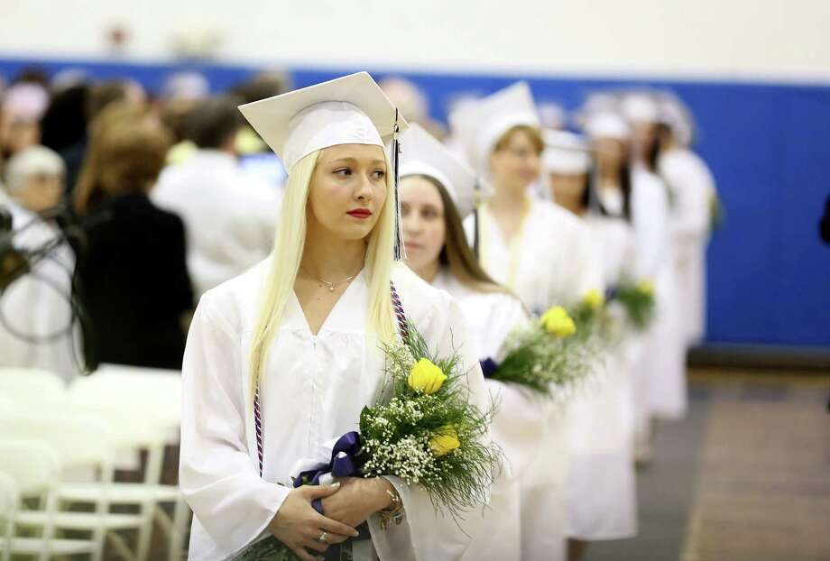 Lauralton High School graduate Camille Amato of West Haven leads the processional with students into the school's gymnasium during Sunday morning commencement  exercises. Photo: Mike Ross / Mike Ross Connecticut Post freelance - @www.mikerossphoto.com
