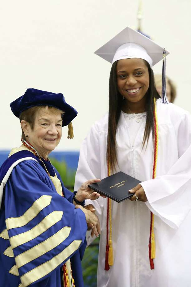 Lauralton Hall High School graduate Rashauna Marie Tracy Banks of Bridgeport poses for a photo as she receives her diploma from the school president Antoinette Ladarola during commencement  exercises on Sunday June 1, 2014. Banks will attend UCONN in the fall. Photo: Mike Ross / Mike Ross Connecticut Post freelance - @www.mikerossphoto.com