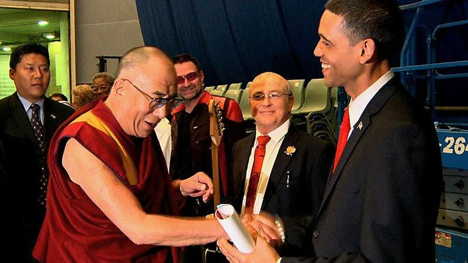 "The real Dalai Lama meets the fake Barack Obama, impersonator Louis Ortiz, in ""Bronx Obama,"" screening at the festival. Photo: DocFest"