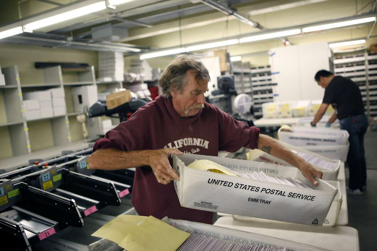Junior clerk Russell Gammon sorts ballots in the audit room at City Hall in San Francisco as early voting opens Saturday.