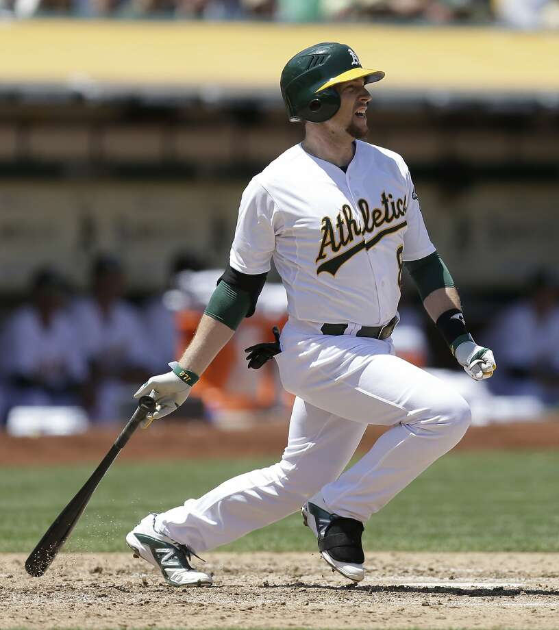 The A's Jed Lowrie, who later homered, delivers an RBI single in the third. Photo: Ben Margot, Associated Press
