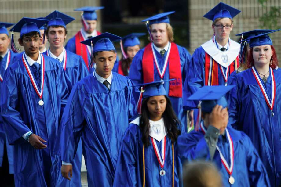Oak Ridge High School graduates walk toward Johnson Coliseum for commencement at Sam Houston State University Saturday, May 31, 2014, in Huntsville. Photo: Brett Coomer, Houston Chronicle / © 2014 Houston Chronicle