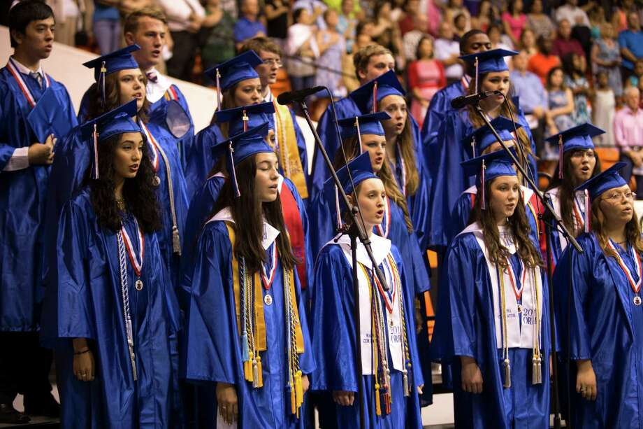 Oak Ridge High School choir sing during commencement at Sam Houston State University Saturday, May 31, 2014, in Huntsville. Photo: Brett Coomer, Houston Chronicle / © 2014 Houston Chronicle