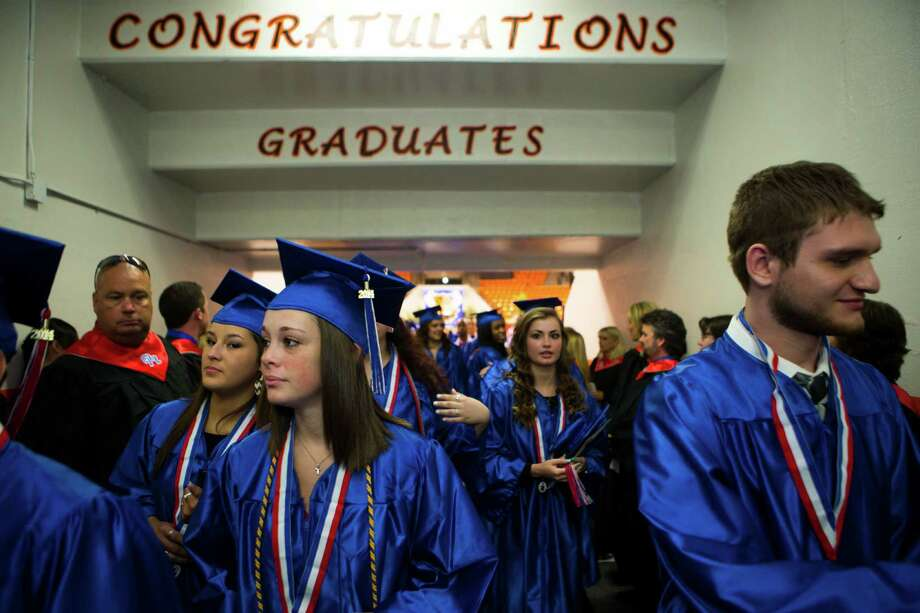 Oak Ridge High School graduates file out of Johnson Coliseum following graduation ceremonies at Sam Houston State University Saturday, May 31, 2014, in Huntsville. Photo: Brett Coomer, Houston Chronicle / © 2014 Houston Chronicle