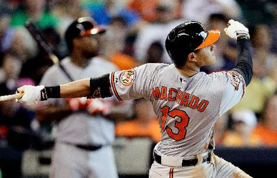 Manny Machado hits a grand slam in the sixth inning. Photo: Bob Levey, Getty Images