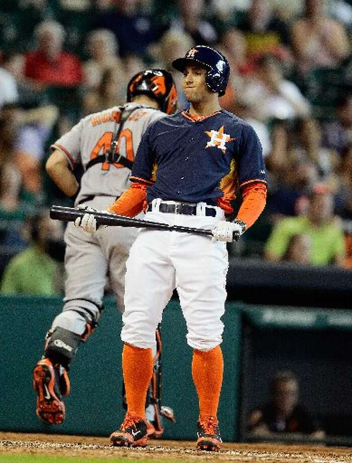 George Springer reacts to striking out in the seventh inning. Photo: Bob Levey, Getty Images