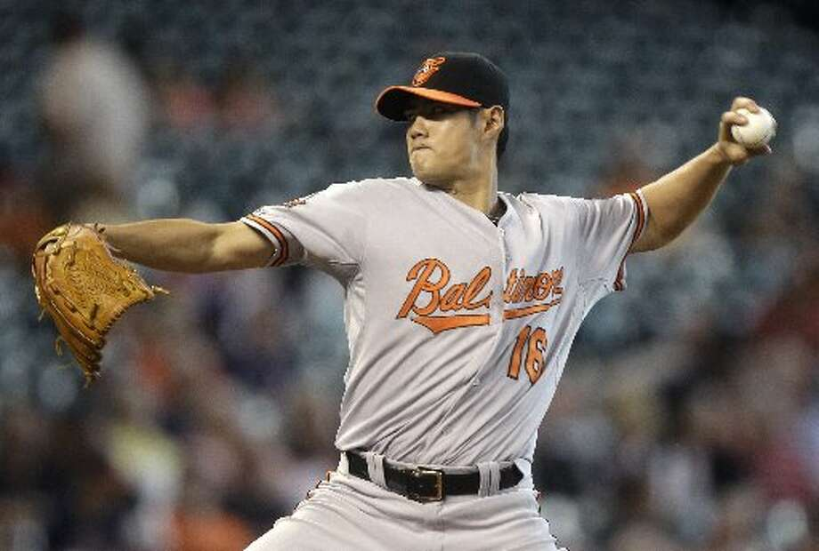 Orioles pitcher Wei-Yin Chen throws during the first inning. Photo: Patric Schneider, Associated Press