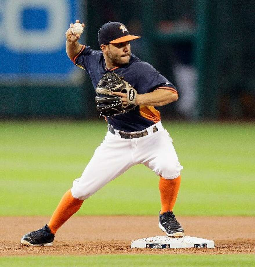 Jose Altuve relays the throw to first base to complete a double play in the first inning. Photo: Bob Levey, Getty Images