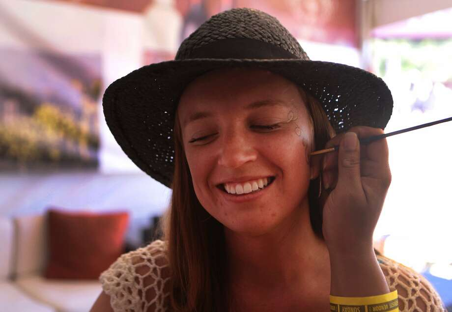 Lauren White of Benicia has her face painted at the Clos Du Val Winery booth at the 2014 Bottlerock Napa Valley music, food and wine festival on Sunday, June 1, 2014 in Napa, Calif. Photo: Kevin N. Hume, The Chronicle