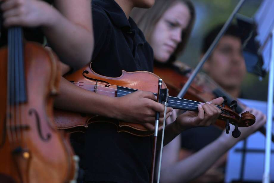 Violinists from the Napa Valley Youth Symphony perform at the 2014 Bottlerock Napa Valley music, food and wine festival on Sunday, June 1, 2014 in Napa, Calif. Photo: Kevin N. Hume, The Chronicle