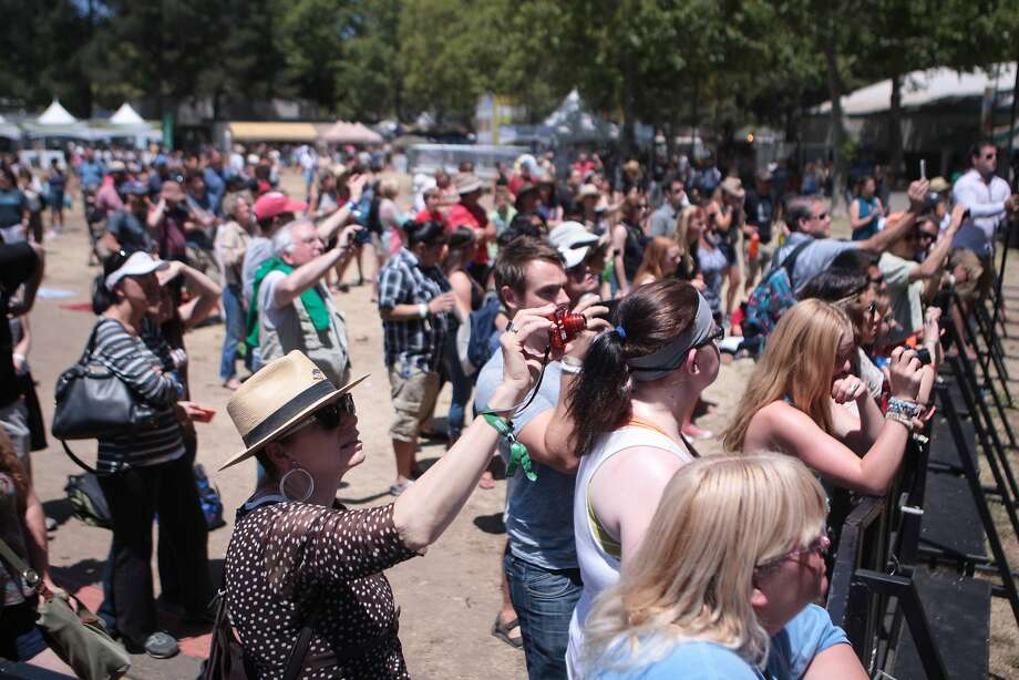 Family, friends and supporters photograph the Napa Valley Youth Symphony during their performance at the 2014 Bottlerock Napa Valley music, food and wine festival on Sunday, June 1, 2014 in Napa, Calif. Photo: Kevin N. Hume, The Chronicle