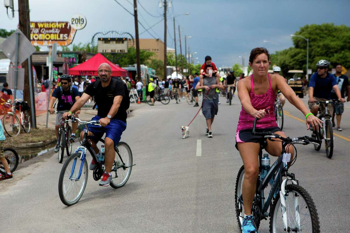 Cyclists enjoy the portion of Washington Avenue closed for pedestrians to exercise without the threat of vehicular traffic during the final day of Sunday Streets HTX, Sunday, June 1, 2014, in Houston.