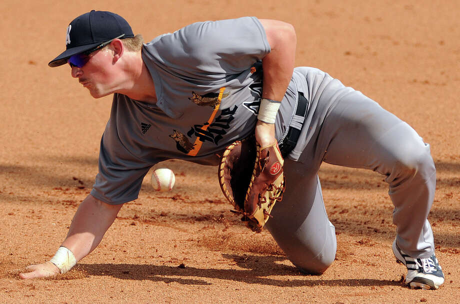 Rice first baseman Skyler Ewing plays the ground ball of Texas A&M's Ryne Birk during the fifth inning of an NCAA baseball regional game, Sunday, June 1,  2014, at Reckling Park in Houston. Photo: Eric Christian Smith, For The Chronicle