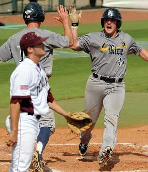 Rice's Skyler Ewing (44) celebrates his run scored with Keenan Cook as Texas A&M pitcher JB Moss looks away during the sixth inning of an NCAA baseball regional game, Sunday, June 1,  2014, at Reckling Park in Houston. Photo: Eric Christian Smith, For The Chronicle
