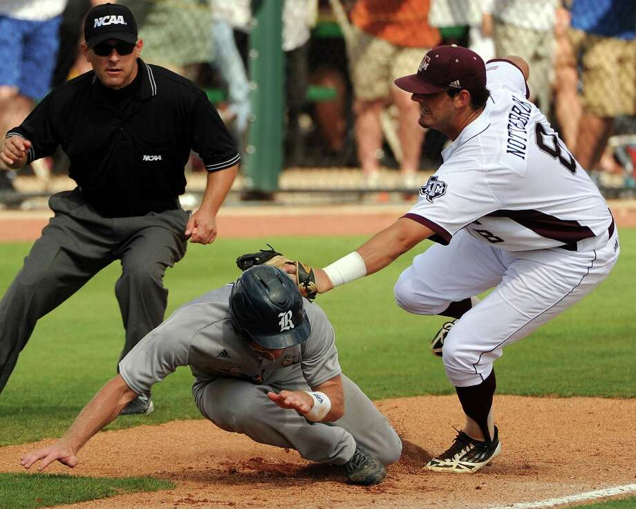 Rice's Shane Hoelscher, left, is tagged out at third base by Texas A&M's Logan Mottebrok during the sixth inning of an NCAA baseball regional game, Sunday, June 1,  2014, at Reckling Park in Houston. Photo: Eric Christian Smith, For The Chronicle