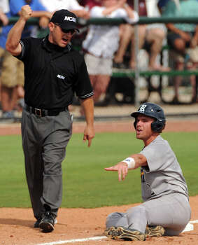 Rice's Shane Hoelscher, right, argues with third base umpire Joe Maiden after Maiden called him out during the inning of an NCAA baseball regional game against Texas A&M, Sunday, June 1,  2014, at Reckling Park in Houston. Photo: Eric Christian Smith, For The Chronicle