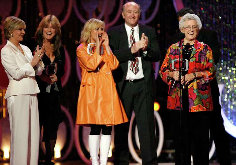 FILE - In this April 14, 2007, file photo, Florence Henderson, from left, Susan Olsen, Maureen McCor