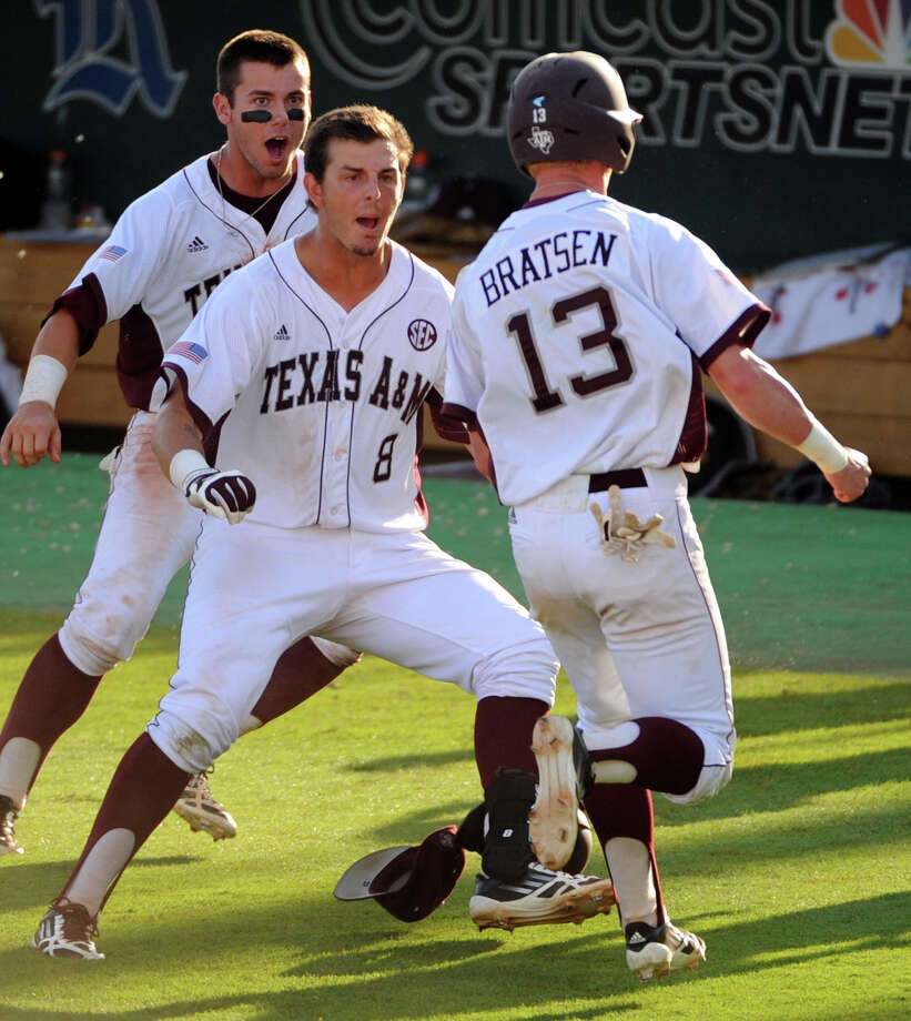 Texas A&M's Krey Bratsen (13) scores the winning run during the tenth inning of an NCAA baseball regional game against Rice, Sunday, June 1, 2014, at Reckling Park in Houston. Texas A&M won the game, 8-7. Photo: Eric Christian Smith, For The Chronicle