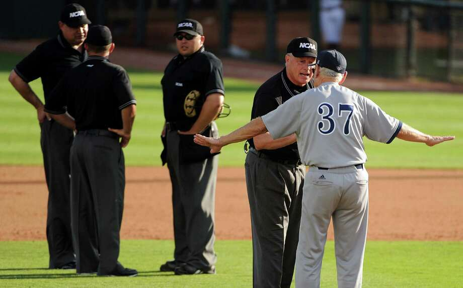 Rice head coach Wayne Graham argues with umpire Frank Sylvester during the tenth inning of an NCAA baseball regional game against Texas A&M, Sunday, June 1,  2014, at Reckling Park in Houston. Photo: Eric Christian Smith, For The Chronicle