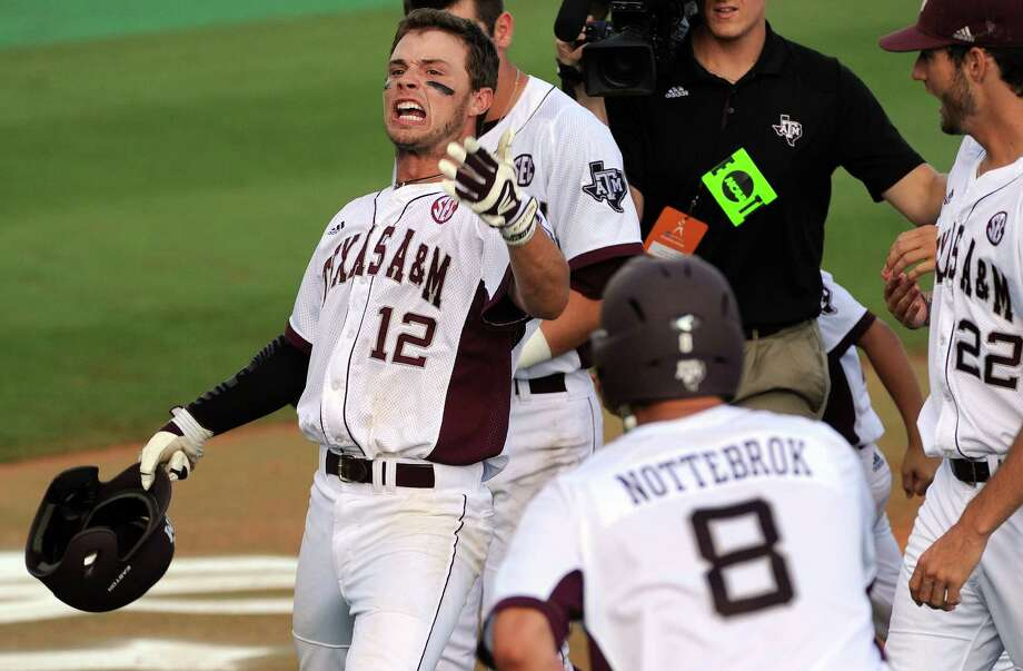 Texas A&M's Cole Lankford (12) celebrates his grand slam during the seventh inning of an NCAA baseball regional game against Rice, Sunday, June 1,  2014, at Reckling Park in Houston. Photo: Eric Christian Smith, For The Chronicle