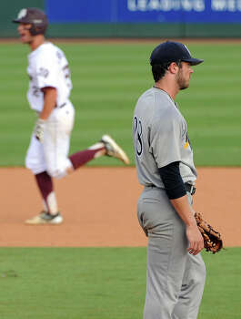 Rice pitcher Blake Fox, right, looks away as Texas A&M's Cole Lankford rounds the bases after hitting a grand slam during the seventh inning of an NCAA baseball regional game, Sunday, June 1,  2014, at Reckling Park in Houston. Photo: Eric Christian Smith, For The Chronicle