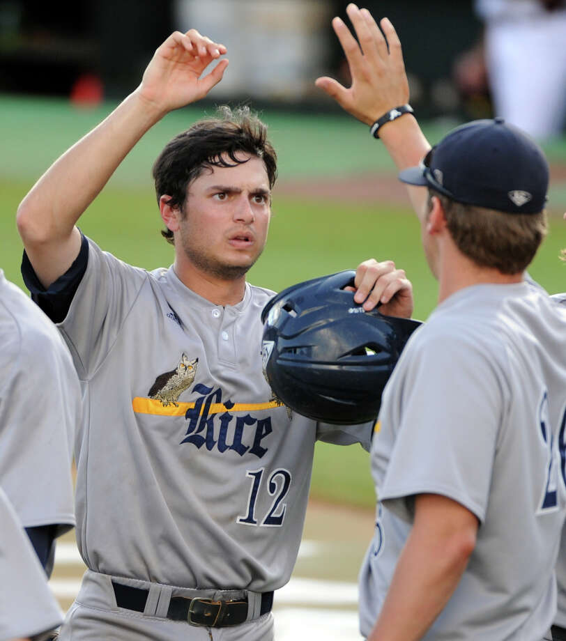 Rice's Kirby Taylor (12) celebrates his go-ahead run during the tenth inning of an NCAA baseball regional game against Texas A&M, Sunday, June 1,  2014, at Reckling Park in Houston. Photo: Eric Christian Smith, For The Chronicle