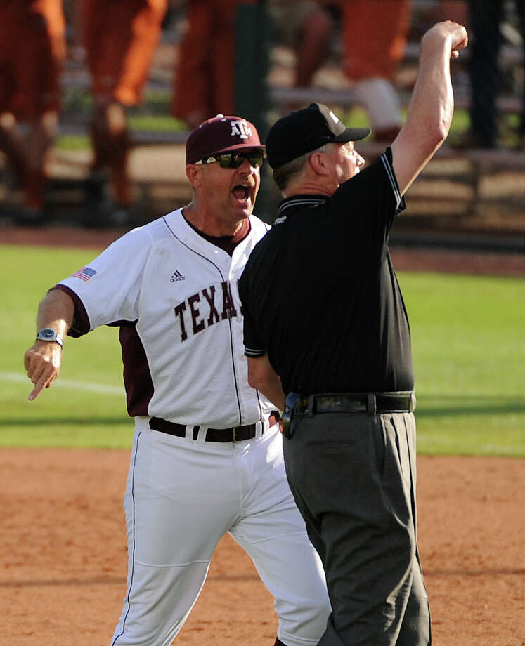 Texas A&M head coach Rob Childress, left, is thrown out of the game by umpire Frank Sylvester during the tenth inning of an NCAA baseball regional game against Rice, Sunday, June 1,  2014, at Reckling Park in Houston. Photo: Eric Christian Smith, For The Chronicle