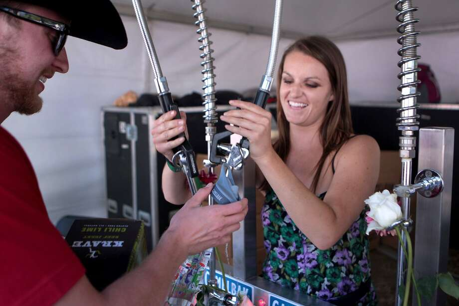 Mallory Prahl, right, of San Luis Obispo fills a fan's water bottle at the 2014 Bottlerock Napa Valley music, food and wine festival on Sunday, June 1, 2014 in Napa, Calif. Photo: Kevin N. Hume, The Chronicle