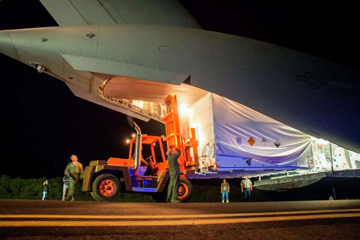 CORRECTS TEST DATE TO JUNE 3, 2014 -This April 17, 2014 image provided by NASA shows workmen unloading a saucer-shaped test vehicle for NASA's Low-Density Supersonic Decelerator (LDSD) project, at the U.S Navy's Pacific Missile Range Facility at Kekaha on the island of Kaua'i in Hawaii. The engineering test flight of this vehicle is scheduled for June 3, 2014. The saucer will be boosted to high altitudes via balloon and rocket, before releasing an inflatable doughnut-shaped tube and an enormous supersonic parachute -- possible landing technologies for future Mars missions.(AP Photo/NASA)