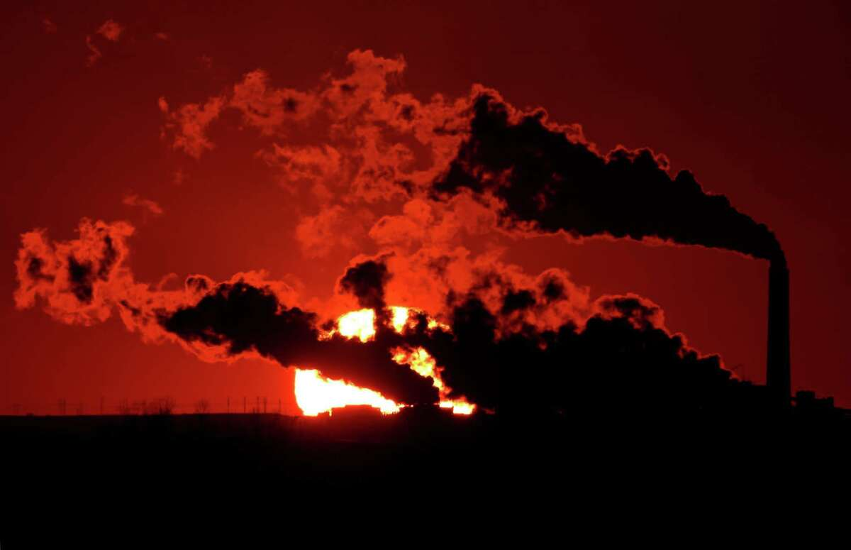 Coal-fire power plants, like this one in Kansas, will be targeted for carbon emissions violations under tougher air quality rules to be announced Monday.