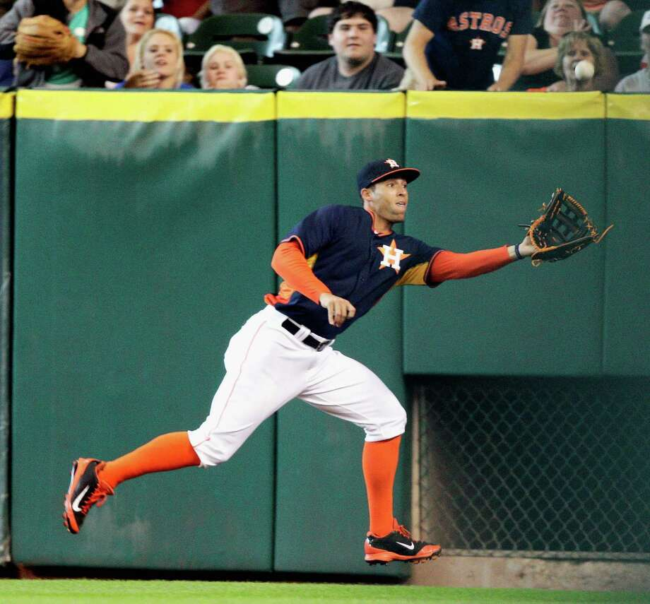 Right fielder George Springer shows his range to take a hit away from the Orioles' Nick Hundley in the sixth. Photo: Bob Levey, Stringer / 2014 Getty Images
