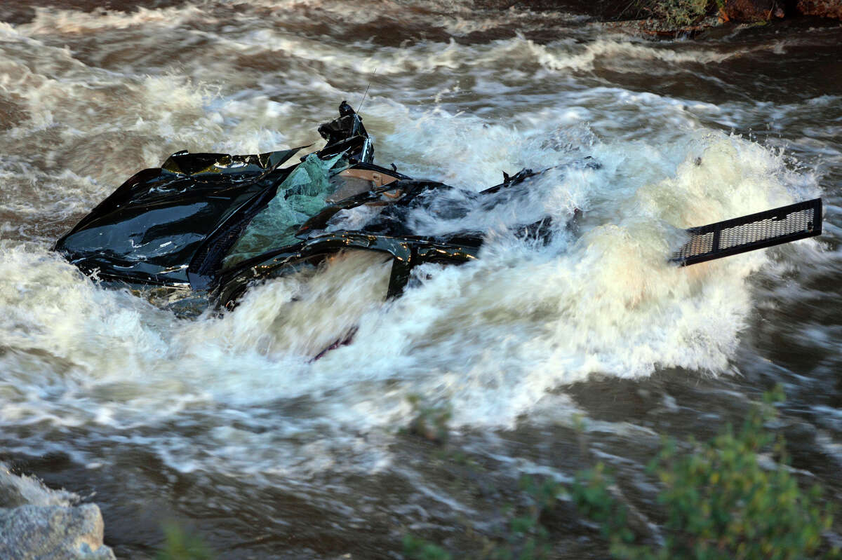 A truck which was in the crash where a woman was found down-stream in Boulder, Colo., on Saturday May 31, 2014. A 13 year-old girl was swept from the vehicle that crashed in the creek upstream. She was pronounced dead after being pulled from the rushing waters.